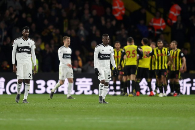WATFORD, ENGLAND - APRIL 02: Andre-Frank Zambo Anguissa and Jean Michael Seri of Fulham look dejected after their team concede during the Premier League match between Watford FC and Fulham FC at Vicarage Road on April 02, 2019 in Watford, United Kingdom. (Photo by Richard Heathcote/Getty Images)