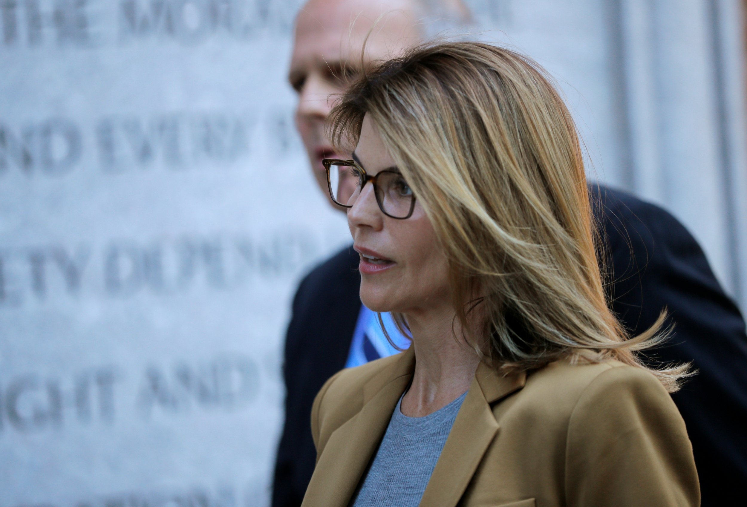 Lori Loughlin 'relying on faith' amid investigation into college admissions scandal as Felicity Huffman pleads guilty