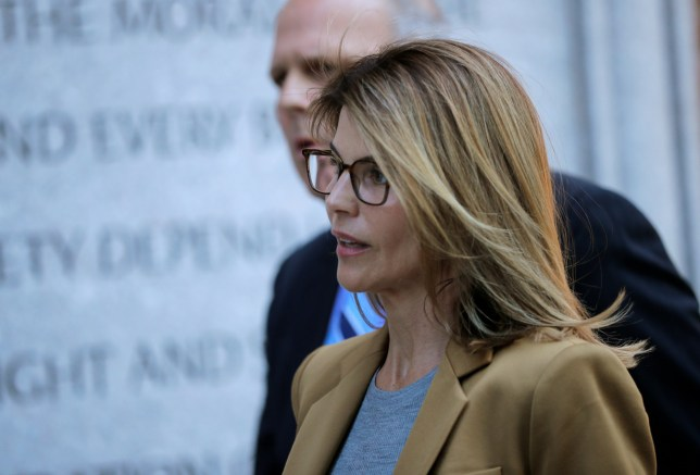 Actor Lori Loughlin, facing charges in a nationwide college admissions cheating scheme, enters federal court in Boston, Massachusetts, U.S., April 3, 2019. REUTERS/Brian Snyder