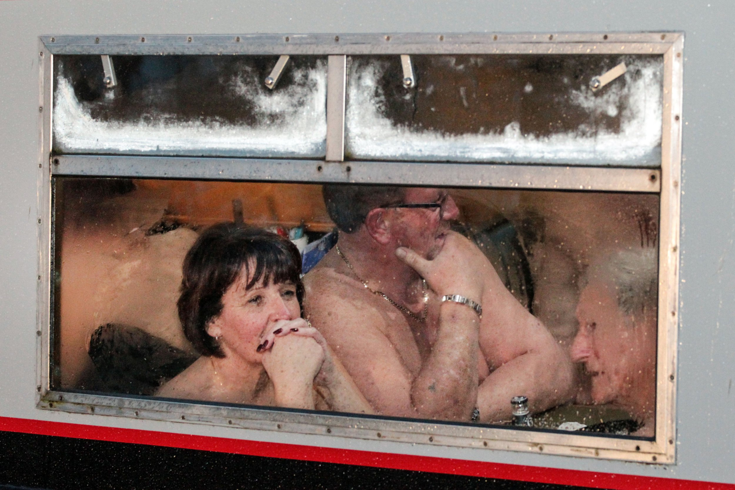 Nudists enjoy fish and chip dinner on naked canal cruise