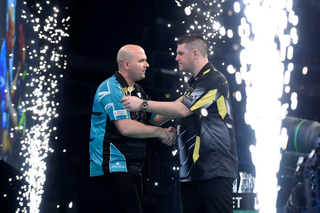 4/4/19: Rob Cross with Daryl Gurney during the Unibet Premier League Darts at the SSE Arena, Belfast. Picture: Michael Cooper