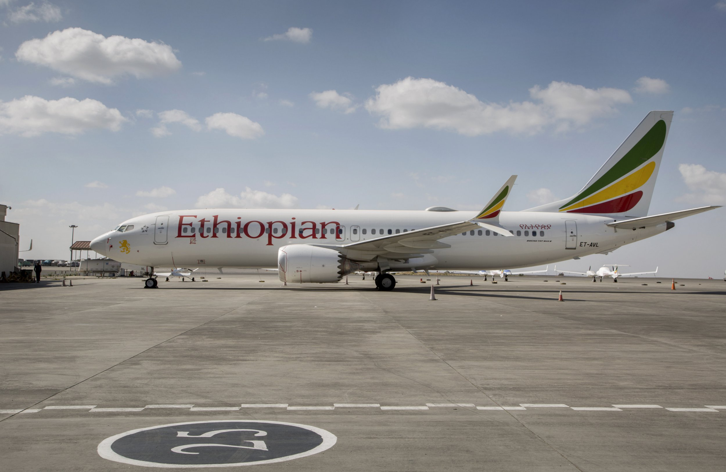 FILE - In tis Saturday, March 23, 2019 file photo, an Ethiopian Airlines Boeing 737 Max 8 sits grounded at Bole International Airport in Addis Ababa, Ethiopia. Pilots of the Ethiopian Airlines flight encountered problems with their new Boeing jetliner from nearly the moment they roared down the runway and took off. A preliminary report on Thursday, April 4, 2019, by Ethiopian investigators reveals a minute-by-minute narrative of the gripping and confusing scene in the cockpit before the March 10 crash. (AP Photo/Mulugeta Ayene, File)