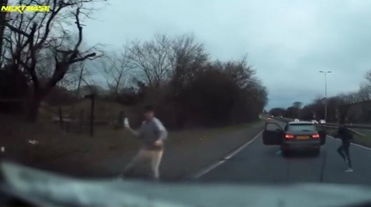 The men are seen jumping out the car throwing a bottle at the driver (Picture: Essex Police)