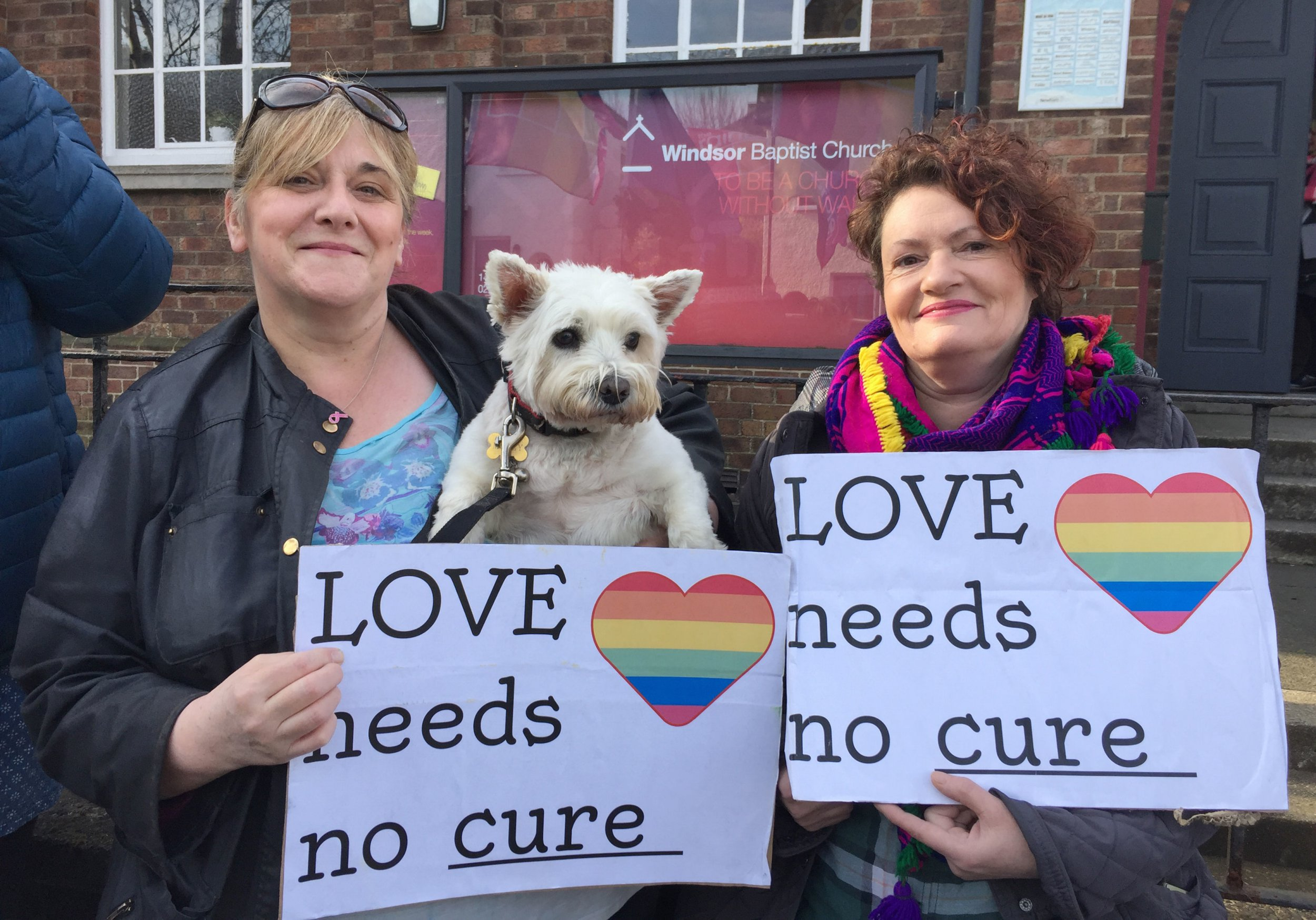 """Shirley McPherson (left) with her dog Molly and Helen Crickard joins campaigners for LGBT rights holding a protest outside Windsor Baptist Church in Belfast where a Christian conference is being held offering support for people experiencing """"same sex temptations"""" organised by the True Freedom Trust. PRESS ASSOCIATION Photo. Picture date: Saturday April 6, 2019. Demonstrators held the peaceful picket outside the church, branding the conference a form of gay conversion therapy. See PA story ULSTER Protest. Photo credit should read: David Young/PA Wire"""