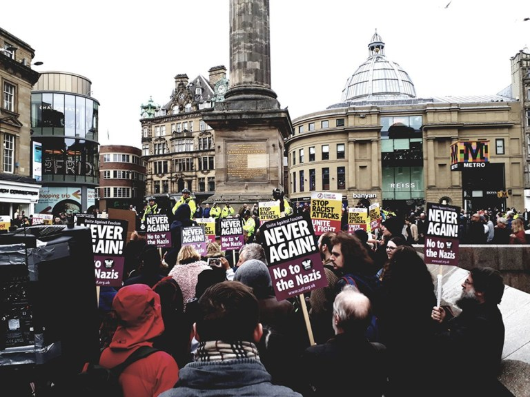 Demo against racism in Newcastle Provider: Unite Against Fascism Source: http://uaf.org.uk/2019/04/press-release-geordie-anti-fascists-with-local-mp-humble-fascist-goons-in-newcastle/?fbclid=IwAR0Q_hNi-ydJW48ZK1jJ5KHp-DfF9DqAdTP62wF_Bn-GXjzri33qGHmtiwU