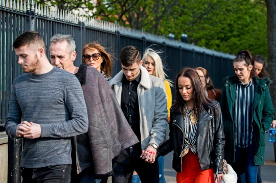 Footballer Jay Donnelly (fourth from left) arriving at Laganside Court in Belfast where a judge reduced his sentence for sharing an indecent image of a child from four months to three following an appeal. PRESS ASSOCIATION Photo. Picture date: Tuesday April 9, 2019. See PA story ULSTER Donnelly. Photo credit should read: Liam McBurney/PA Wire
