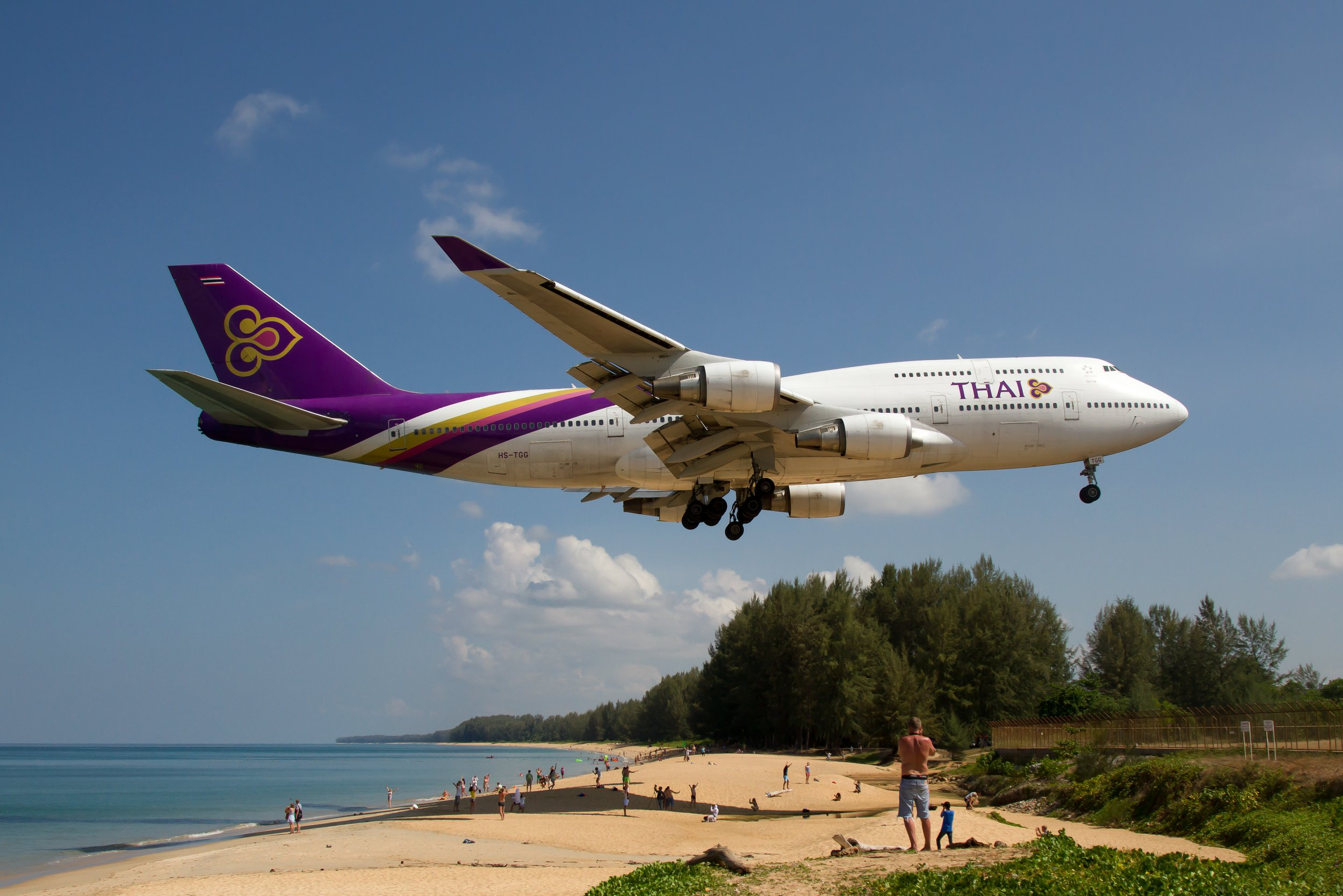 MAI KHAO BEACH, PHUKET, THAILAND - 2018/03/20: Thai Airways Boeing 747-400 about to complete a domestic flight from Bangkok and landing at Phuket over Mai Khao beach. (Photo by Fabrizio Gandolfo/SOPA Images/LightRocket via Getty Images)