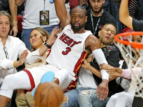 Dwyane Wade falling on John Legend and Chrissy Teigen at Miami Heat game is a photo that needs to be framed