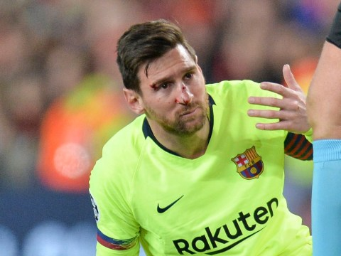 Manchester United fans sing 'Viva Ronaldo' at Lionel Messi after Barcelona star was forced off with bloodied face at Old Trafford