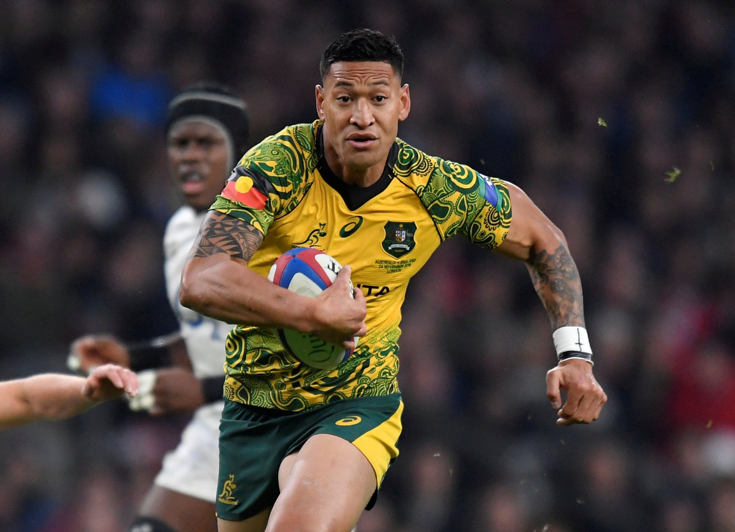 FILE PHOTO: Rugby Union - England v Australia - Twickenham Stadium, London, Britain - November 24, 2018 Australia's Israel Folau runs in to score their first try REUTERS/Toby Melville/File Photo