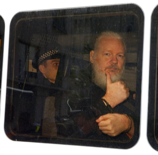 WikiLeaks founder Julian Assange is seen in a police van after was arrested by British police outside the Ecuadorian embassy in London, Britain April 11, 2019. REUTERS/Henry Nicholls TPX IMAGES OF THE DAY