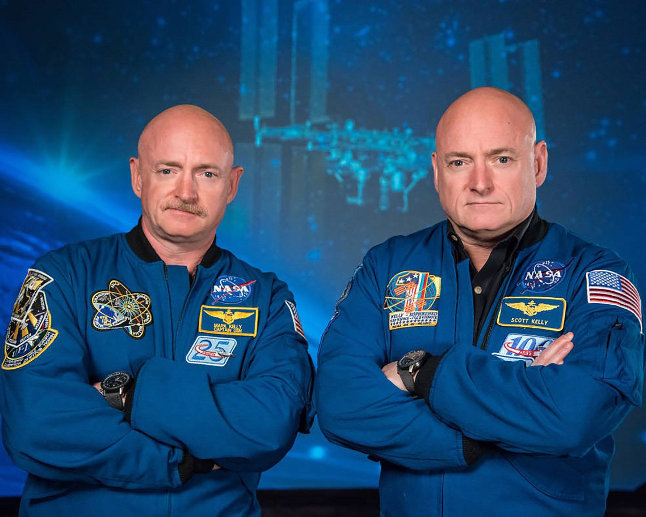 Recent photo released by NASA shows former astronaut Scott Kelly (R), who was the Expedition 45/46 commander during his one-year mission aboard the International Space Station, along with his twin brother, former astronaut Mark Kelly (L). - The Twins Study, by the Journal Science, is helping scientists better understand the impacts of spaceflight on the human body through the study of identical twins. Retired astronaut Scott Kelly spent 340 days in low-Earth orbit aboard the International Space Station while retired astronaut Mark Kelly, his identical twin, remained on Earth. The twins genetic similarity provided scientists with a reduced number of variables and an ideal control group, both important to scientific investigation. (Photo by Robert MARKOWITZ / NASA / AFP)ROBERT MARKOWITZ/AFP/Getty Images