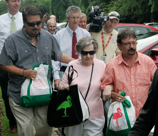 Powerball winner Gloria C. Mackenzie, 84, leaves the lottery office escorted by her son Scott Mackenzie, right, after claiming a single lump-sum payment of about $370.9 million before taxes on Wednesday, June 5, 2013, in Tallahassee, Fla. Officials say she is the largest sole lottery winner in U.S. history. She did not speak to reporters outside lottery headquarters, leaving in a silver Ford Focus with family members. (AP Photo/Steve Cannon)