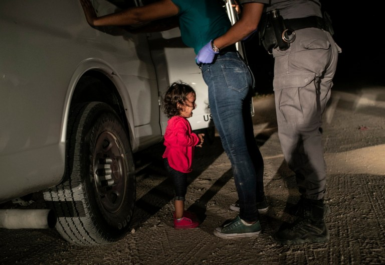 """In this image released by the World Press Photo Foundation Thursday April 11, 2019, by John Moore, Getty Images, which won the World Press Photo of the Year and the first prize in the Spot News, Singles, category, titled """"Crying Girl on the Border"""", shows Honduran toddler Yanela Sanchez crying as she and her mother, Sandra Sanchez, are taken into custody by US border officials in McAllen, Texas, USA, on 12 June 2018. (John Moore, Getty Images, World Press Photo Foundation via AP)"""