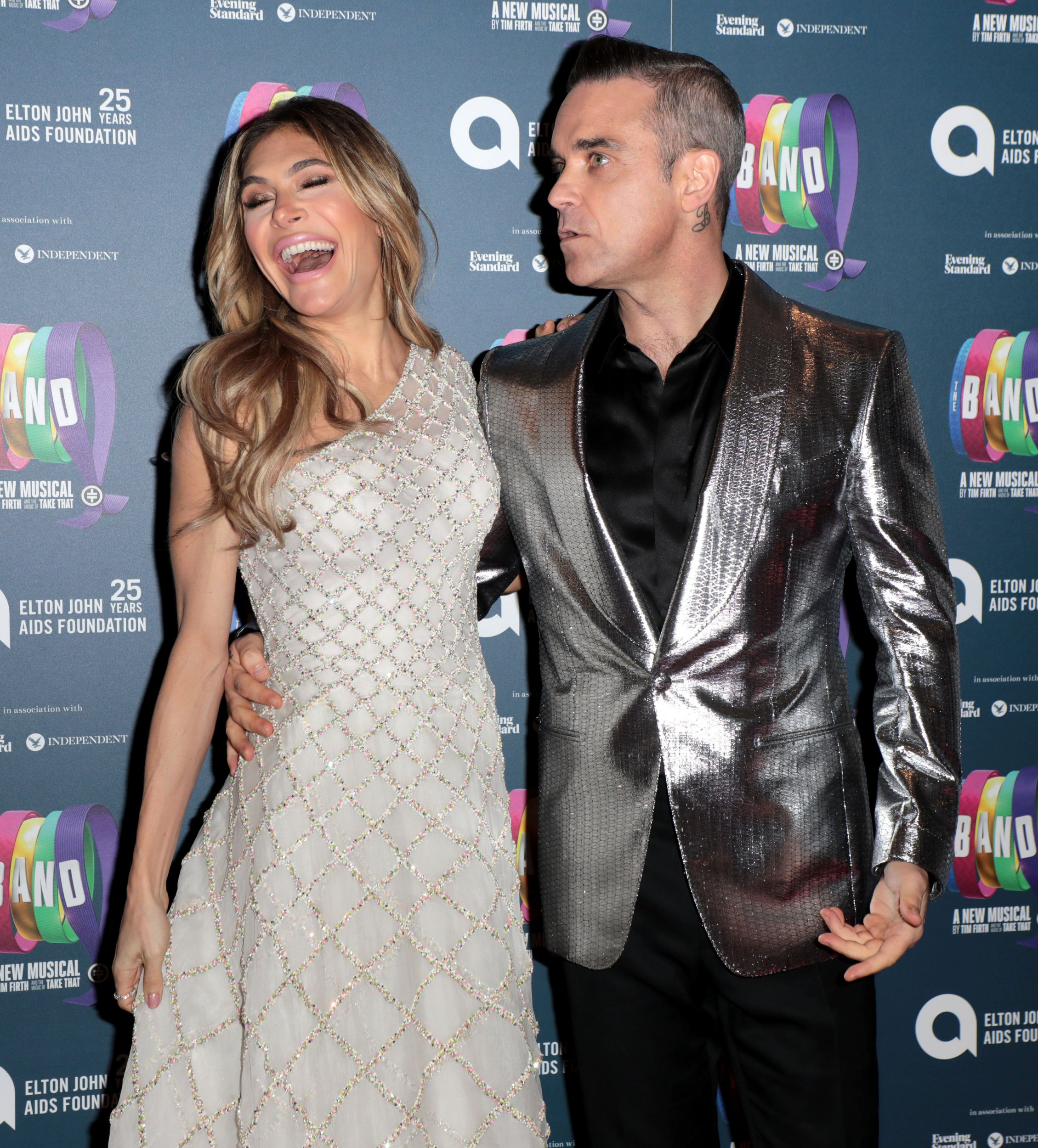 Robbie Williams asks Ayda Field to marry him again