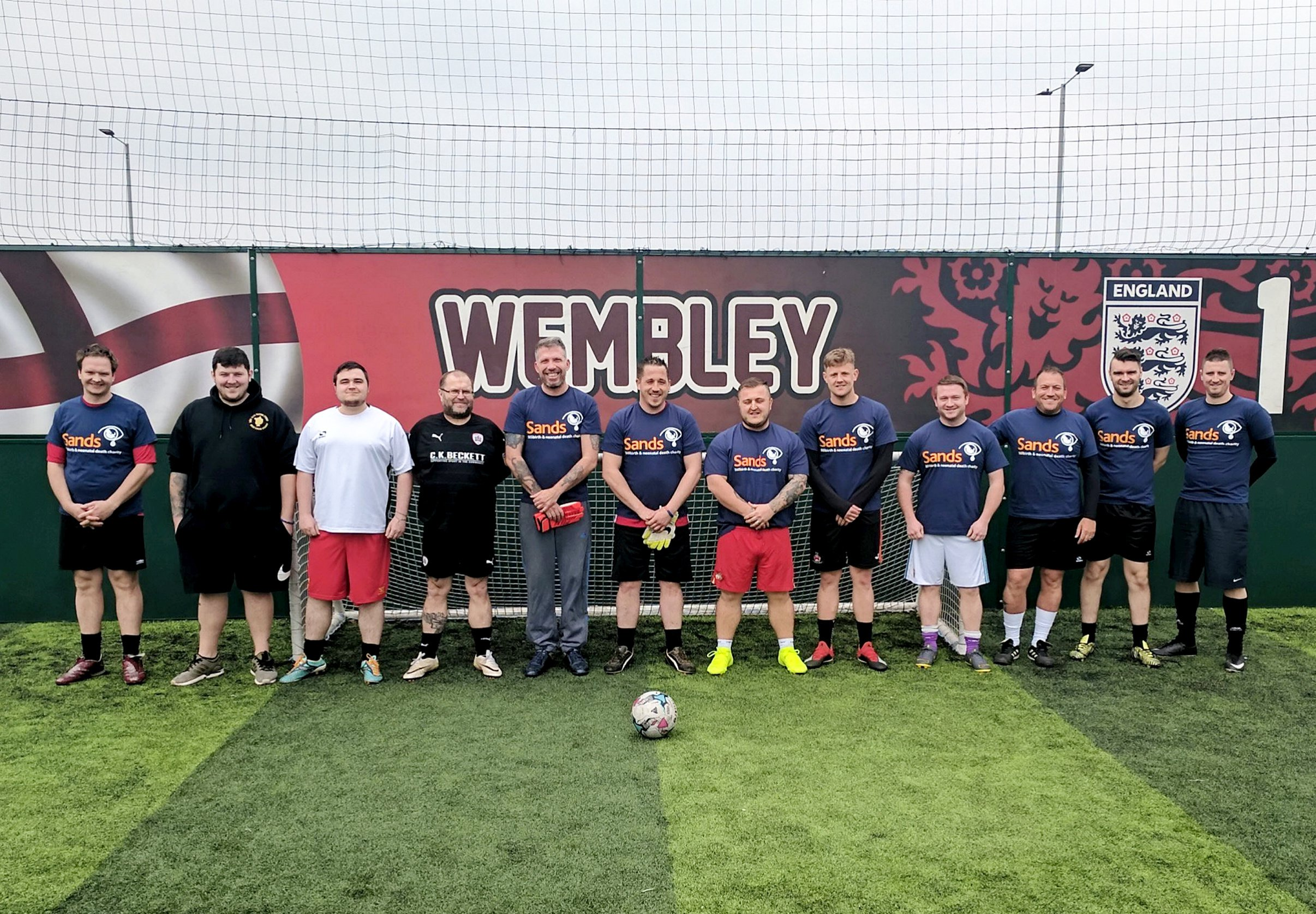 """Grieving dads form football team and wear their 'lost angels"""" names on their shirts"""