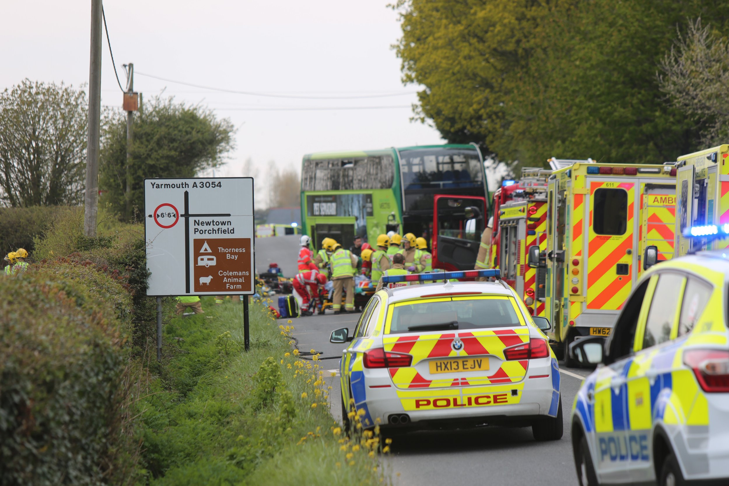 One person has sadly died at the scene of a horrific crash on the outskirts of the Newport on the Isle of Wight. Emergency services were called to a serious crash on Forest Road on the outskirts of Newport this afternoon involving a Southern Vectis bus and two other vehicles. Fire crews from the Isle of Wight Fire and Rescue Service have been called to the incident and they are working to free one person who is trapped in the wreckage.