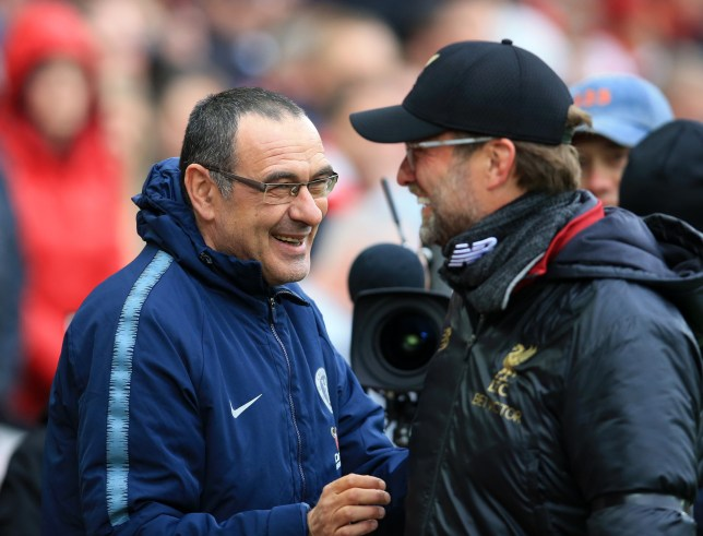14th April 2019, Anfield, Liverpool, England; EPL Premier League football, Liverpool versus Chelsea; Chelsea manager Maurizio Sarri shares a joke with Liverpool manager Jurgen Klopp as they shake hands prior to the kick off (photo by David Blunsden/Action Plus via Getty Images)