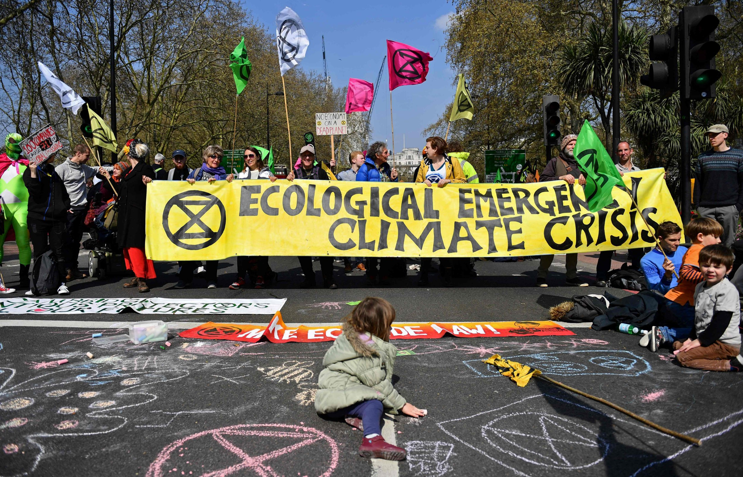 """Environmental protesters from the Extinction Rebellion group stage a demonstration in a road near Marble Arch in London on April 15, 2019. - Environmental protesters from the Extinction Rebellion campaign group started a programme of demonstrations designed to block five of London's busiest and iconic locations to draw attention to what they see as the """"Ecological and Climate Emergency"""" of climate change. (Photo by Daniel LEAL-OLIVAS / AFP)DANIEL LEAL-OLIVAS/AFP/Getty Images"""