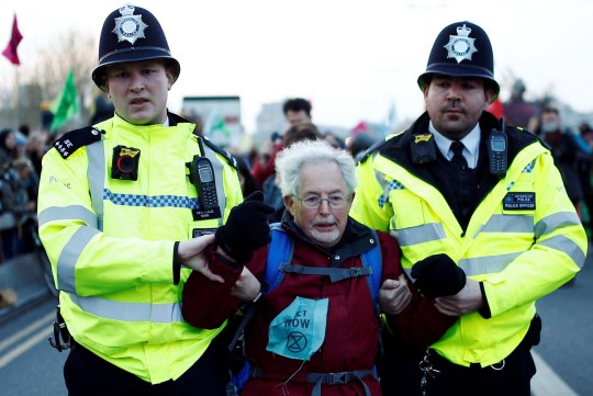 Police detain a protester as climate change activists demonstrate during a Extinction Rebellion protest at the Waterloo Bridge in London, Britain April 15, 2019. REUTERS/Henry Nicholls