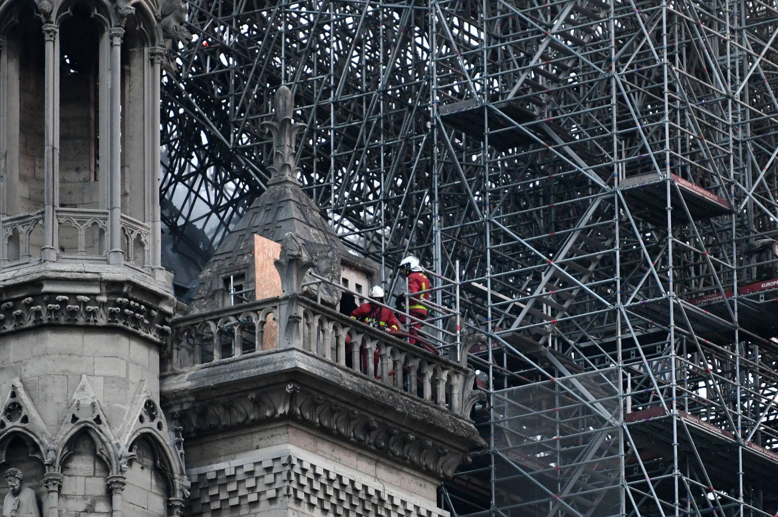 "Firefighters work to extinguish a fire at Notre-Dame Cathedral in Paris early on April 16, 2019. - A huge fire that devastated Notre-Dame Cathedral is ""under control"", the Paris fire brigade said early on April 16 after firefighters spent hours battling the flames. (Photo by STEPHANE DE SAKUTIN / AFP)STEPHANE DE SAKUTIN/AFP/Getty Images"