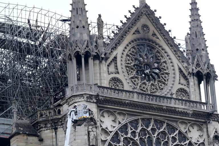 Firefighters work at Notre-Dame Cathedral in Paris, France April 16, 2019. A massive fire consumed the cathedral on Monday, gutting its roof and stunning France and the world. REUTERS/Yves Herman