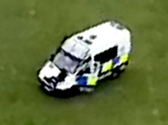 This is the moment a man was run over by a police van which had broken up a crowd of youths in Scotland after appearing to jump on its front windscreen. See SWNS story SWSYram. According to a local eyewitness, who wished to remain anonymous, two youths were bundled into two police vans on Monday evening at 6.30pm in Moredun, Edinburgh. The arrests were made after Police Scotland, who were contacted by disturbed residents, broke up a crowd of at least 30 hooded young men dressed in black. The 34-year-old gardener said he was on the phone to his girlfriend in his 14th floor flat overlooking the green near the Royal Infirmary when he heard a commotion. Sending the video to his girlfriend on Snapchat, he saw two vans hurtle towards the group and chase one down, who seemed to jump onto the front windscreen. The eyewitness said there were six vehicles -- four vans and two cars -- parked on the green in total over the following hour, as police patrolled the area. He said that the police appeared to be searching for something in the grass, while the group of youths jeered at the officers from the side. The eyewitness claimed that police had made the arrest after an attempted murder on Gilmerton Road the previous evening. Police Scotland said the two cases were being treated separately, though enquiries are still ongoing into both incidents and any link.