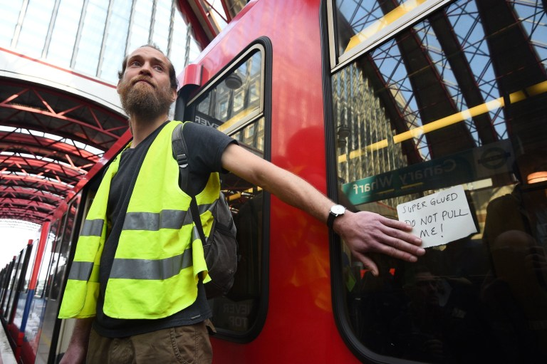 A climate activist after he glued himself to a Dockland Light Railway at Canary Wharf station in east London as part of the ongoing climate change protests in the capital. PRESS ASSOCIATION Photo. Picture date: Wednesday April 17, 2019. See PA story ENVIRONMENT Climate. Photo credit should read: Kirsty O'Connor/PA Wire