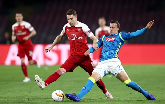 Editorial use only Mandatory Credit: Photo by James Marsh/BPI/REX (10213607ac) Aaron Ramsey of Arsenal and Vlad Chiriches of Napoli. Napoli v Arsenal, UEFA Europa League Quarter Final, Second Leg, Football, Stadio San Paolo, Naples, Italy - 18 Apr 2019