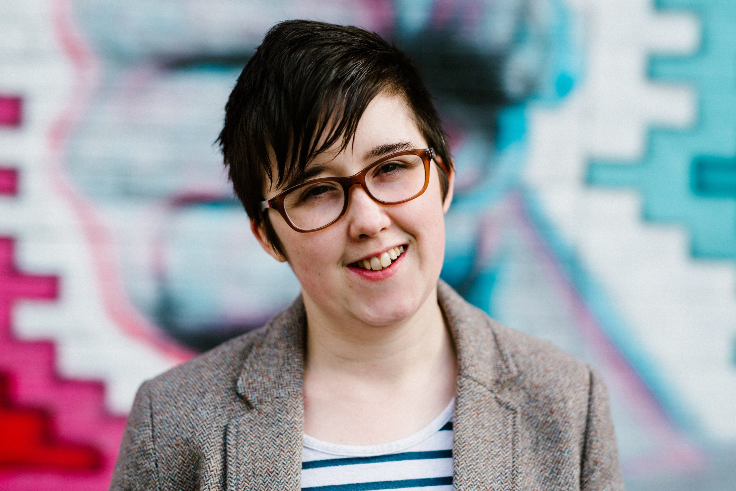 Jouralist Lyra McKee smiling while looking into the camera