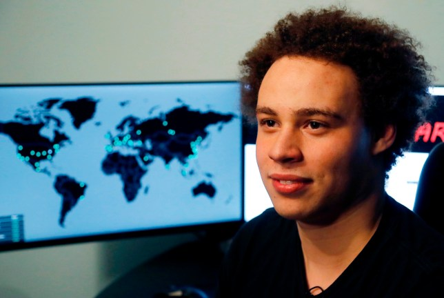 FILE - This Monday, May 15, 2017, file photo shows Marcus Hutchins, a British cybersecurity expert during an interview in Ilfracombe, England. The British cybersecurity researcher hailed as a hero for credited with stopping a worldwide computer virus in 2017 has pleaded guilty to developing malware to steal banking information. Federal prosecutors in Wisconsin and Hutchins??? attorneys say in a Friday, April 19, 2019 filing that the 24-year-old is pleading guilty to developing the malware and conspiring to distribute it from 2012 to 2015. In exchange for his plea to those two charges, prosecutors are dismissing eight others. (AP Photo/Frank Augstein, File)
