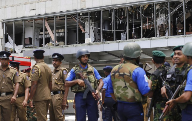 epa07519448 Police and security personnel stand gaurd after an explosion hit Shangri-La Hotel in Colombo, Sri Lanka, 21 April 2019. According to news reports at least 138 people killed and over 400 injured in a series of blasts during the Easter Sunday service at St Anthony's Church in Kochchikade, Shangri-La Hotel and Kingsbury Hotel with many more places. EPA/M.A. PUSHPA KUMARA