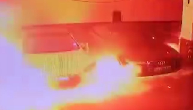 Pic shows: The Tesla burning in the car park. CHINA: This viral video viewed more than 10 million times shows a Tesla Model S left in a car park suddenly catching fire and exploding without warning.