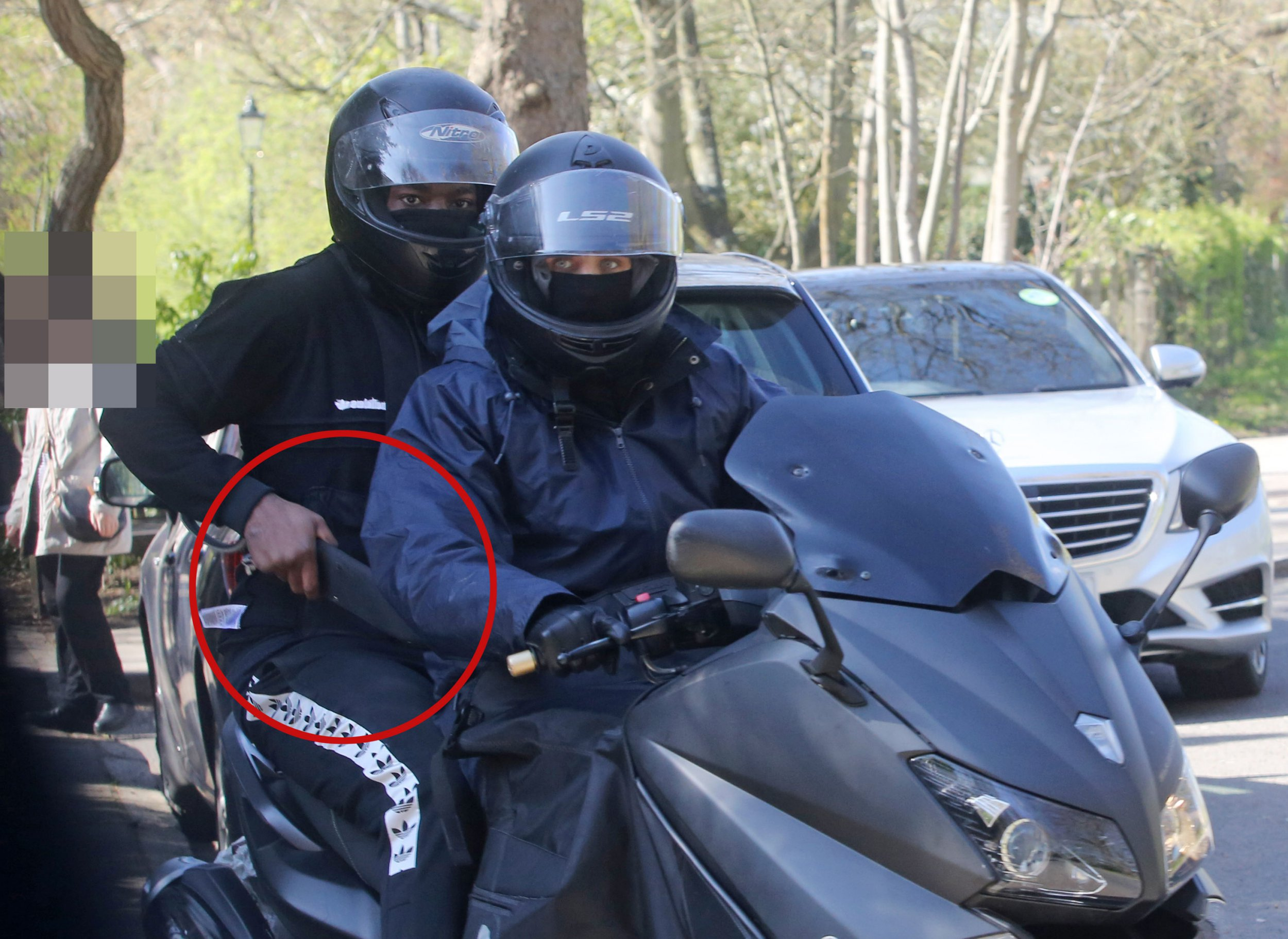 Picture captures moped thief holding huge knife 'moments after stealing man's Rolex'