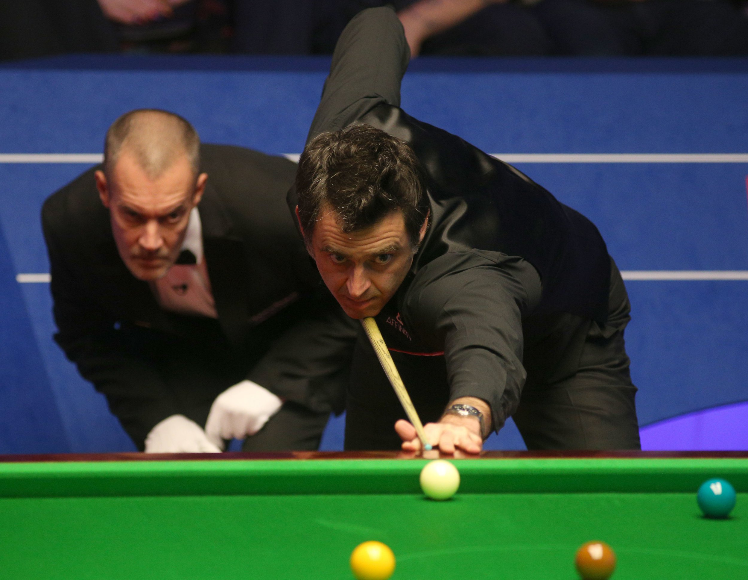 Ronnie O'Sullivan plays a shot as arbitrate Olivier Marteel watches during day 3 of a 2019 Betfred World Championship during The Crucible, Sheffield. PRESS ASSOCIATION Photo. Picture date: Monday Apr 22, 2019. See PA story SNOOKER World. Photo credit should read: Nigel French/PA Wire