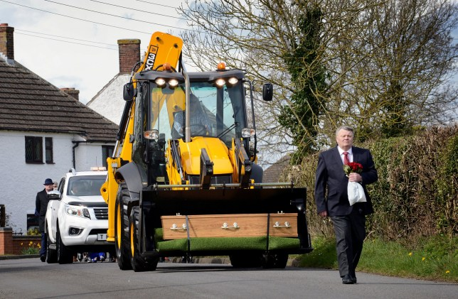 A digger-driving great-grandad was given a fitting send off when his family transported his coffin to his funeral in the bucket of his favourite JCB. See SWNS story SWMDdigger. Geoffrey Durham's coffin was loaded onto the bright yellow earth mover before being driven to his final resting place. The 74-year-old died on March 23, days after collapsing as he got ready for work and was laid to rest in his hometown of Old Somerby, Lincs., on April 12. His eldest grandson, Tommy Finney, came up with the idea of using a JCB to transport the coffin to the funeral, as a fitting tribute to his grandad. Geoffrey, who had been married to his wife Valerie for 52 years, had worked in construction for more than 30 years and had a particular interest in JCBs.