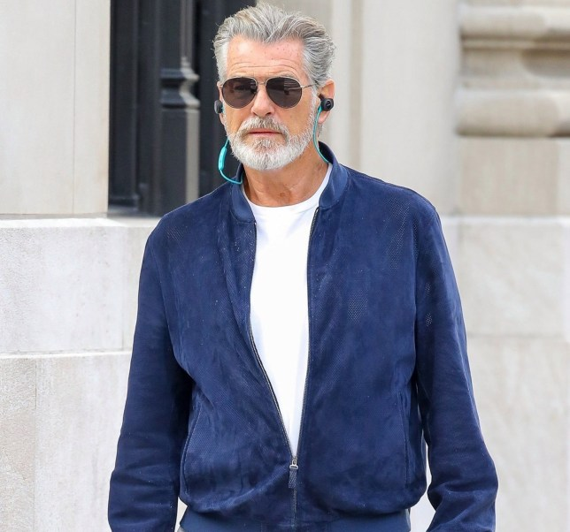 New York, NY - *EXCLUSIVE* - Pierce Brosnan has his earphones in and is completely tuned in to his own world as the veteran actor walks through The Big Apple without any company. Pictured: Pierce Brosnan BACKGRID USA 23 APRIL 2019 BYLINE MUST READ: Spartano / BACKGRID USA: +1 310 798 9111 / usasales@backgrid.com UK: +44 208 344 2007 / uksales@backgrid.com *UK Clients - Pictures Containing Children Please Pixelate Face Prior To Publication*