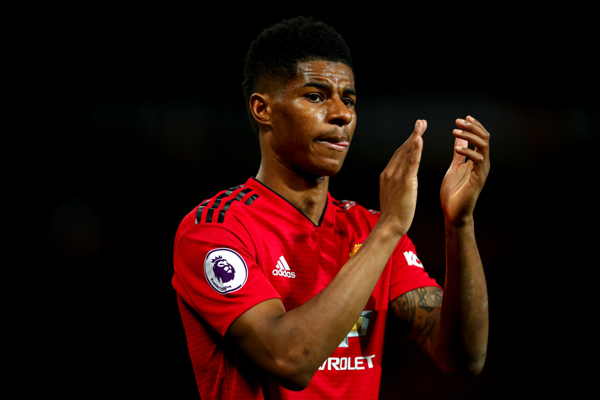 MANCHESTER, ENGLAND - APRIL 24: Marcus Rashford of Manchester United applauds the fans at full time during the Premier League match between Manchester United and Manchester City at Old Trafford on April 24, 2019 in Manchester, United Kingdom. (Photo by Robbie Jay Barratt - AMA/Getty Images)
