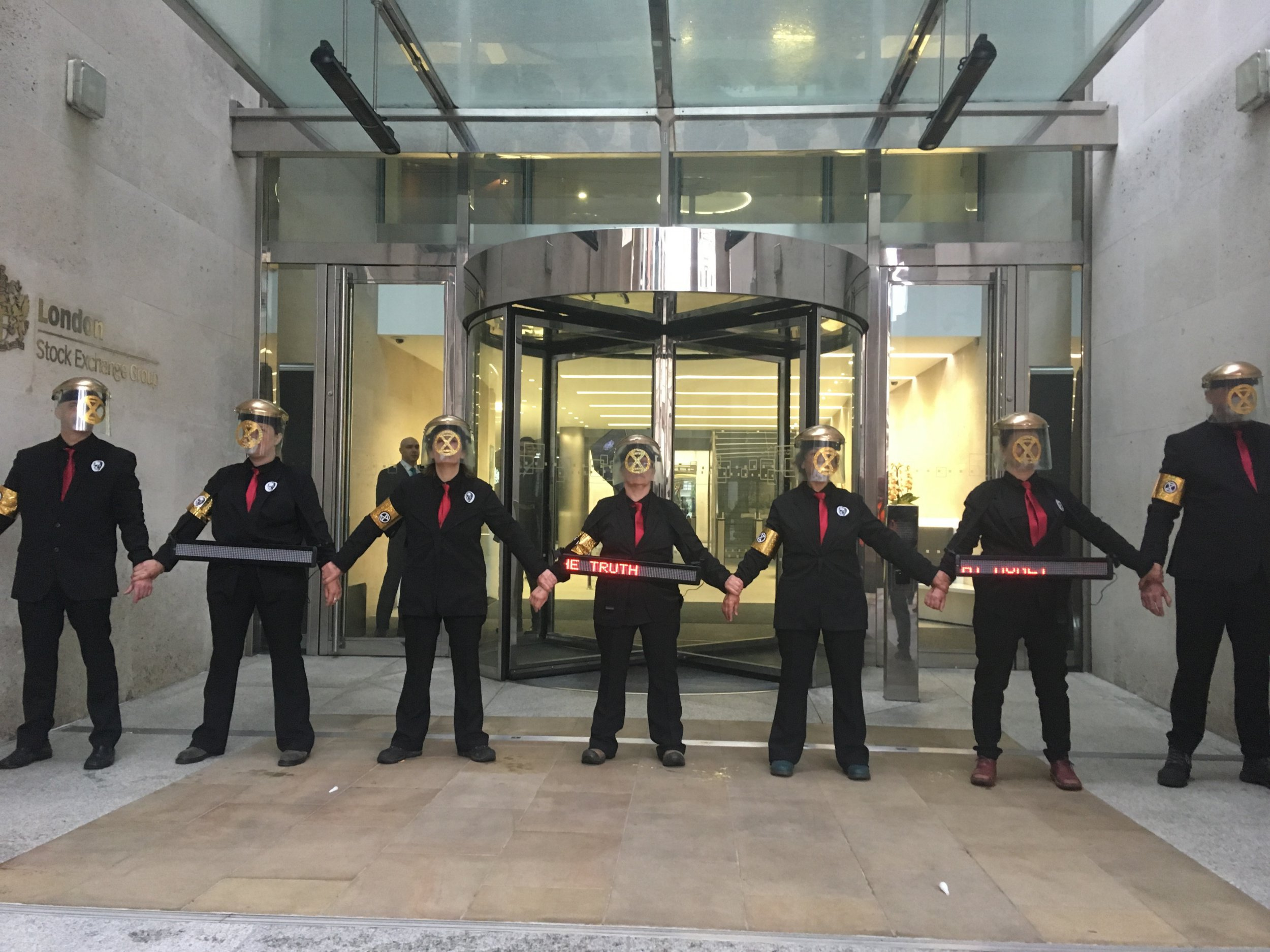 Climate protesters target London Stock Exchange and Canary Wharf
