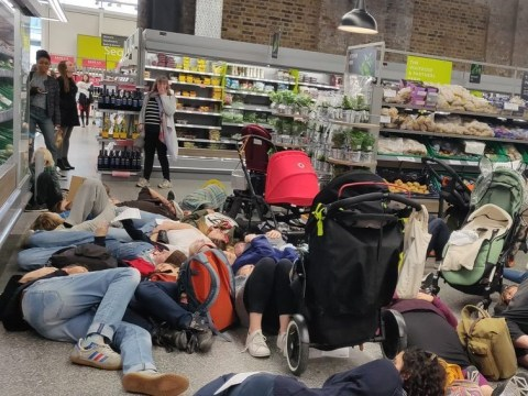 Climate protesters play dead with their children in Waitrose