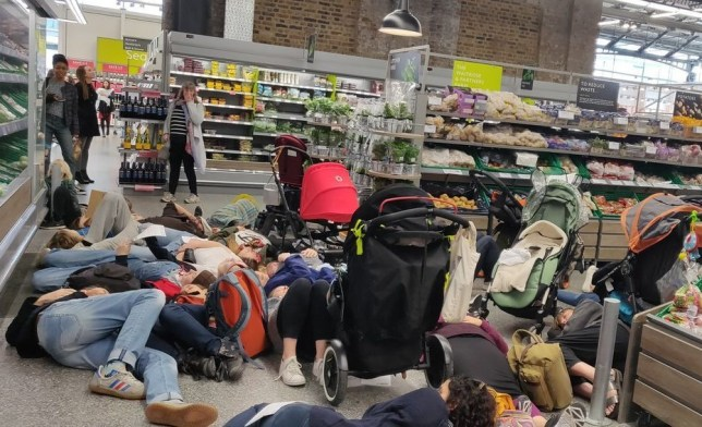 METRO GRAB - taken with permission from Ed O'Meara - agreed fee ?50 x2 Extinction Rebellion hit Waitrose Picture: Ed O'Meara
