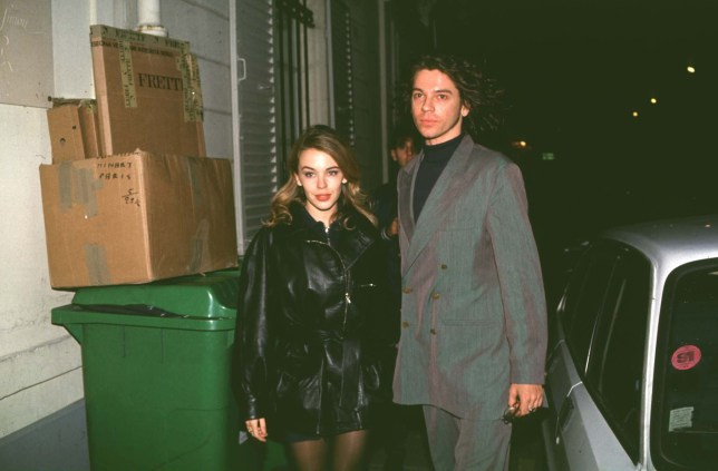 Kylie Minogue and Michael Hutchence attend the Chanel Haute Couture collection fall winter launch
