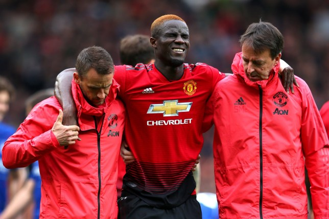 Eric Bailly of Manchester United is given assistance during the Premier League match between Manchester United and Chelsea FC at Old Trafford on April 28, 2019 in Manchester, United Kingdom. (Photo by Alex Livesey/Getty Images)