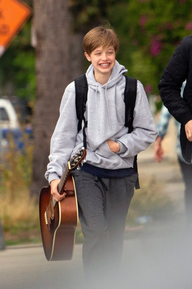 Los Angeles, CA - *EXCLUSIVE* - An animated looking Shiloh Jolie-Pitt is all smiles as she goes to guitar lessons in Los Angeles. The pre-teen held on to her guitar and looked very happy as she headed to class with her music teacher. Pictured: Shiloh Jolie-Pitt BACKGRID USA 29 APRIL 2019 USA: +1 310 798 9111 / usasales@backgrid.com UK: +44 208 344 2007 / uksales@backgrid.com *UK Clients - Pictures Containing Children Please Pixelate Face Prior To Publication*