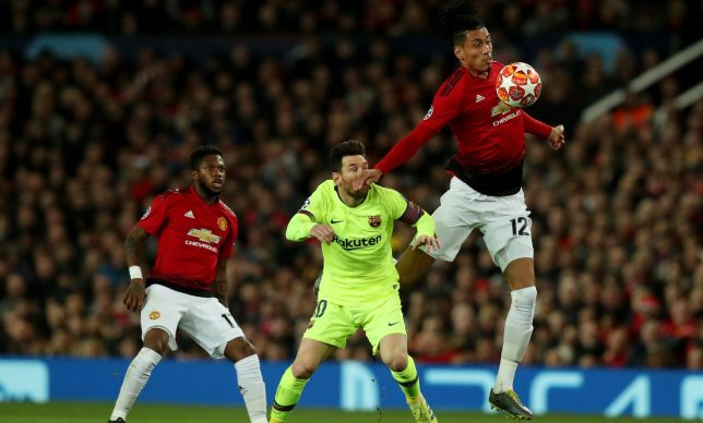 Manchester United star Chris Smalling caught Barcelona's Lionel Messi with a flailing arm