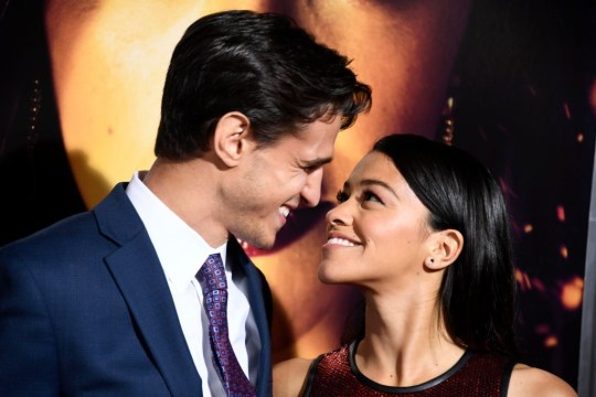 """LOS ANGELES, CALIFORNIA - JANUARY 30: (L-R) Joe Locicero and Gina Rodriguez attend the Premiere Of Columbia Pictures' """"Miss Bala"""" at Regal LA Live Stadium 14 on January 30, 2019 in Los Angeles, California. (Photo by Frazer Harrison/Getty Images)"""