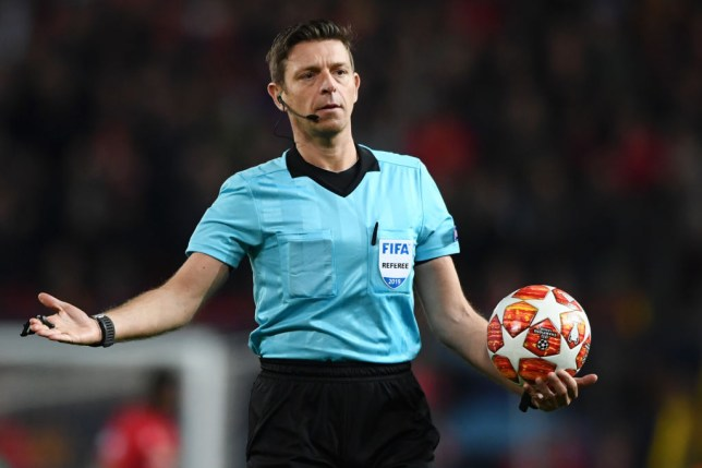 Gianluca Rocchi reacts while holding a ball during a Champions League Quarter Final in final