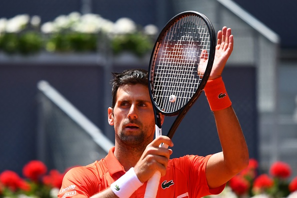 Novak Djokovic awaits Roger Federer or Dominic Thiem as Marin Cilic withdraws with illness