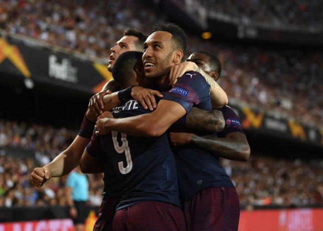 VALENCIA, SPAIN - MAY 09: Pierre-Emerick Aubameyang celebrates scoring a goal for Arsenal with Alexandre Lacazette and Granit Xhaka during the UEFA Europa League Semi Final Second Leg match between Valencia and Arsenal at Estadio Mestalla on May 9, 2019 in Valencia, Spain. (Photo by David Price/Arsenal FC via Getty Images)