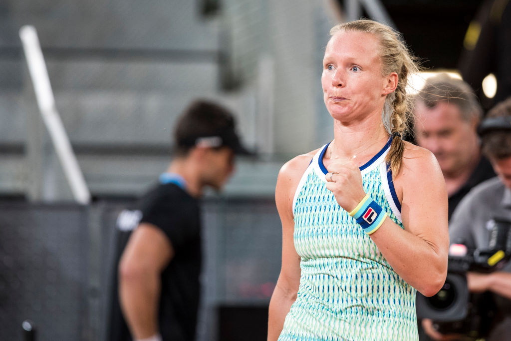 Kiki Bertens fist pumps after winning a point against Simona Halep